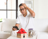 Asian man stress on high property Royalty Free Stock Image