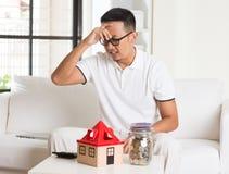 Asian man stress on high property Stock Photo
