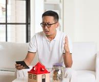 Asian man stress on high property Royalty Free Stock Photos