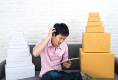 Asian man Stressed about business SME online stock images