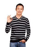 Asian Man In Striped Pullover Royalty Free Stock Image