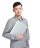 Asian man student with laptop. Isolated on white Royalty Free Stock Photography