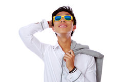 Asian man in sunglasses looking up Stock Photos