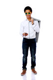 Asian man in sunglasses using smarthone Stock Photo