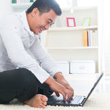 Asian man surfing internet Stock Image