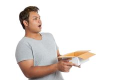 Asian man surprise look at space over an open box Stock Photo