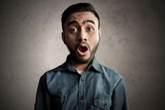 Asian man surprised and shock. Ed Royalty Free Stock Photo
