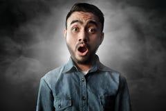 Asian men surprised on smoke background. Asian man surprised on smoke background Royalty Free Stock Image