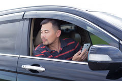 Asian man taking mobile phone in hand Royalty Free Stock Photography