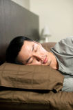 Asian Man taking a nap Royalty Free Stock Photos