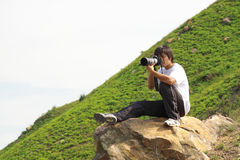 Asian man taking photo Royalty Free Stock Photos