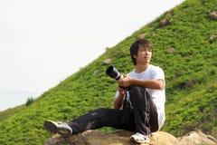 Asian man taking photo Stock Image