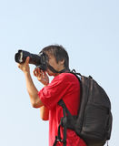 Asian man taking photo Stock Photo