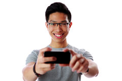 Asian man taking photo with smartphone Royalty Free Stock Photo