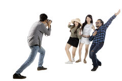 Asian man taking picture his friends on studio Royalty Free Stock Photo