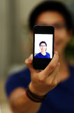 Asian man taking self picture with smartphone Royalty Free Stock Photography