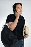 Asian man talking on a mobile phone Royalty Free Stock Photo