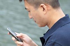 Asian man talking on phone Royalty Free Stock Image