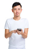 Asian man text message Stock Photography