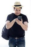 Asian man texting message at his mobile phone Stock Photography