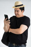 Asian man texting message at his mobile phone Royalty Free Stock Image