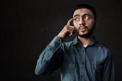 Asian man think on black background Royalty Free Stock Photos