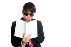 Asian man think wihile reading book Stock Photo