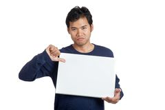 Asian man thumbs down with a blank sign Royalty Free Stock Photo