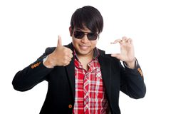 Asian man thumbs up with a card Royalty Free Stock Image