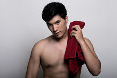 Asian man with towel in the hand. Photo of Asian man with towel in the hand stock photo