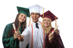 Asian man and two women graduates Royalty Free Stock Photo