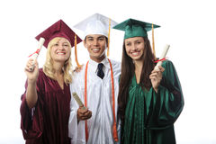 Asian man and two women graduates Royalty Free Stock Images