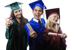 Asian man and two women graduates Royalty Free Stock Photos