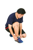 Asian Man Tying Sport Shoes. Stock Image
