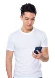 Asian man use of the cellphone Stock Images