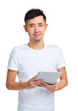 Asian man use digital tablet Royalty Free Stock Photo