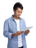 Asian man use of digital tablet Stock Image
