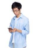 Asian man use mobile phone Stock Photos