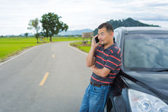 Asian man use mobile phone Royalty Free Stock Images