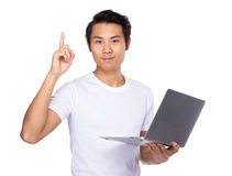 Asian man use notebook computer and finger up Royalty Free Stock Images