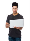 Asian man use of the notebook computer Royalty Free Stock Photography