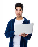 Asian man use of the notebook computer Royalty Free Stock Photo