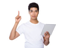 Asian man use of tablet and finger point up Stock Photography