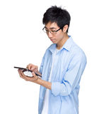 Asian man use tablet Royalty Free Stock Images