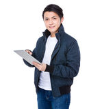 Asian Man use of tablet Stock Images