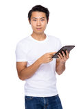 Asian man use of tablet Royalty Free Stock Photos