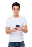 Asian man using the cellphone for playing game Royalty Free Stock Photography