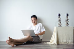 Asian Man Using Laptop Royalty Free Stock Photos