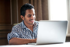 Asian Man Using a laptop Royalty Free Stock Photos