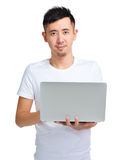 Asian man using laptop computer Stock Image
